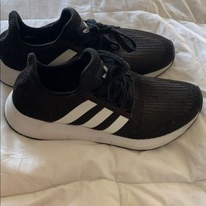 Adidas black sneaker with white stripes size 9.5
